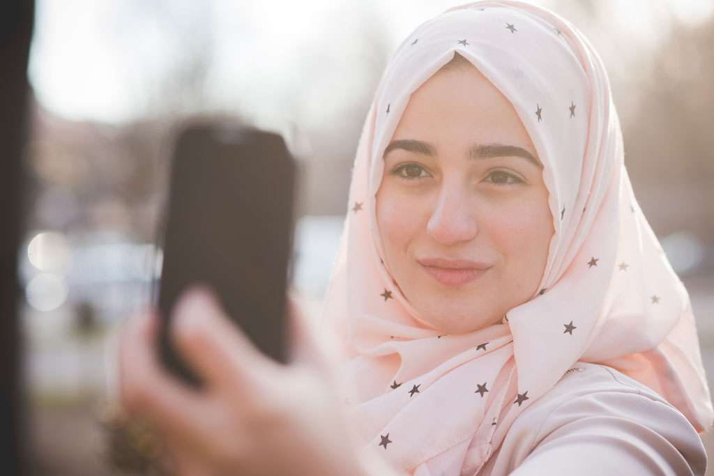 young beautiful muslim woman at the park